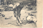Girl splitting Wood - Sierra Leone
