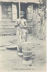 Temne woman beating rice