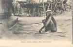 Temne woman weaving a mat, Sierra Leone